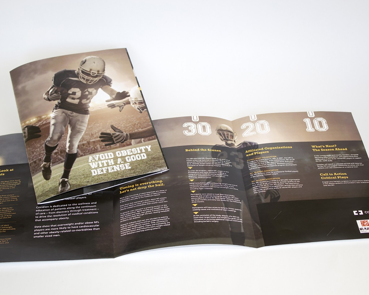 """We paired NFL marketing collateral such as action-oriented player photographs with the vital information and health tips, and the football theme was expanded to include a faux-pigskin covered """"Playbook"""" containing additional information, brochures, and actionable lifestyle tips. Our brand strategy and comprehensive messaging also extended to other fun items for those who want to support the partnership, such as exclusive branded jerseys, footballs, and promotional materials to help create buzz around the obesity risk healthcare program."""