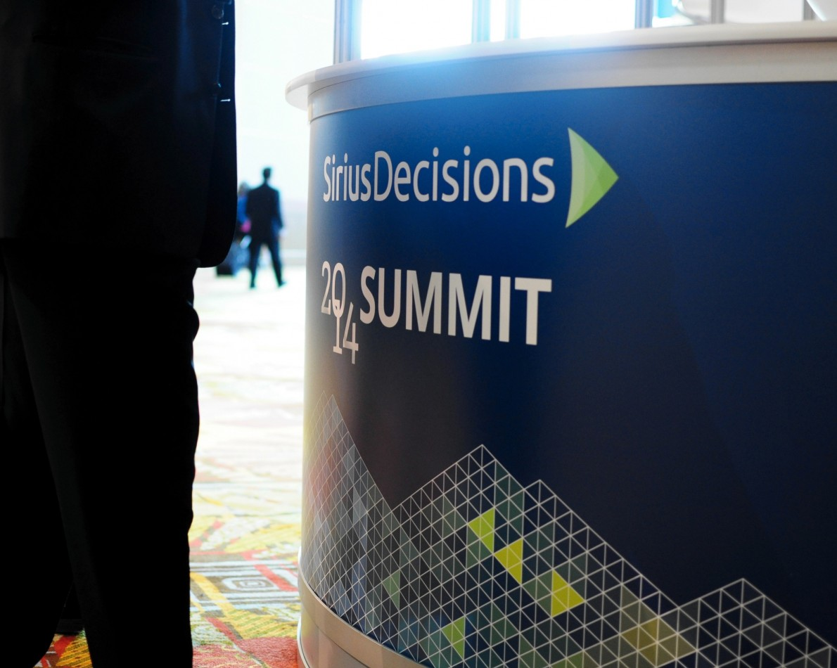 The goal for conference signage: sophistication meets practicality. Using the new brand guidelines to enhance the experience of attending the 2014 Summit Conference.