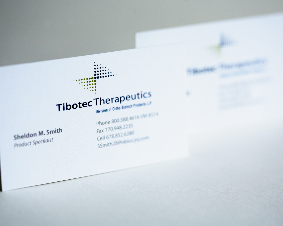 Business cards featuring the new logo.