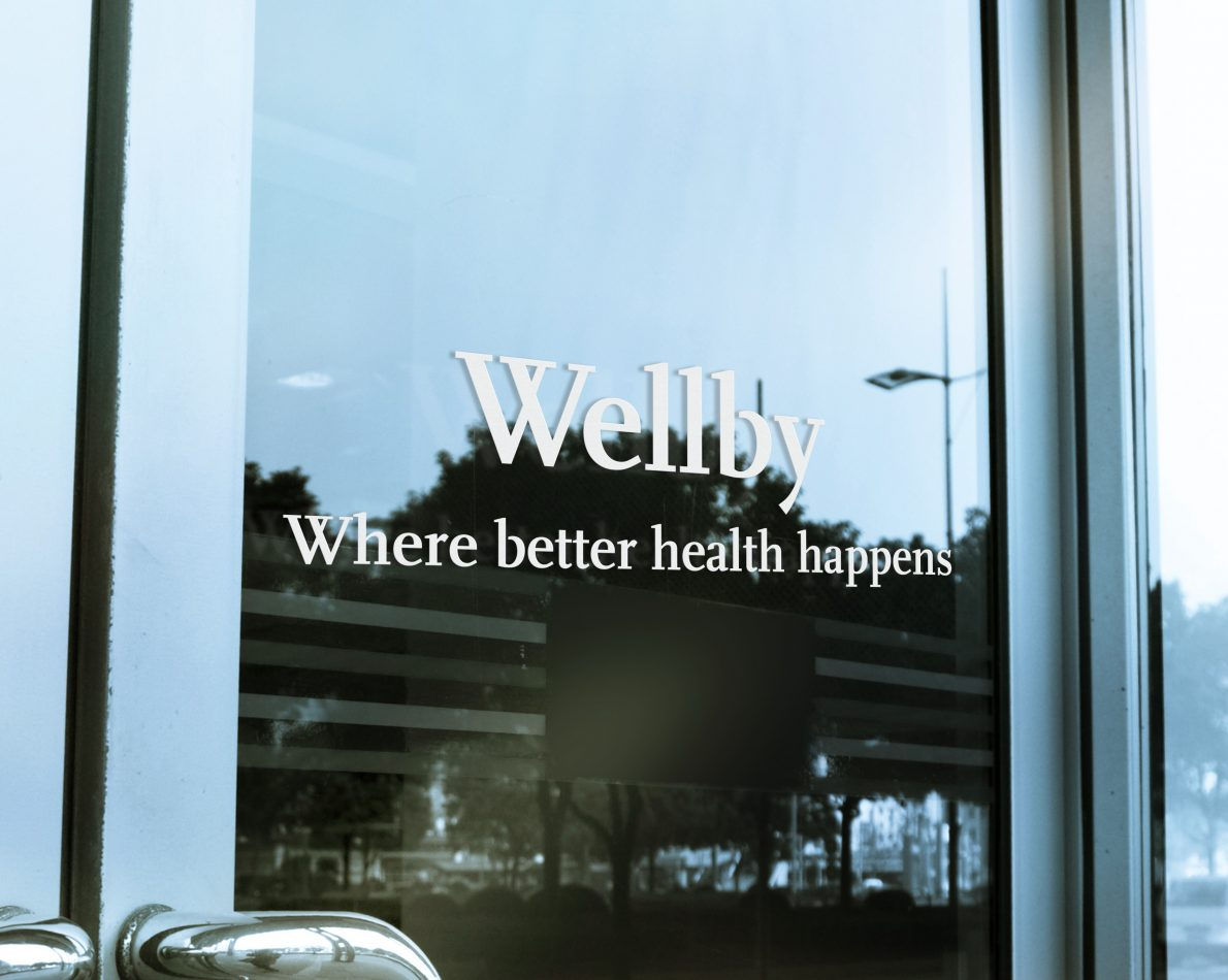 Consistent brand messaging in Wellby window signage.