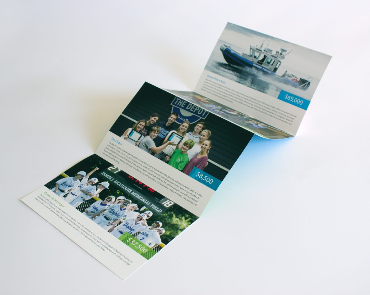 The 4-fold accordion brochure has plenty of space to show the funds raised for the year and how they were applied.